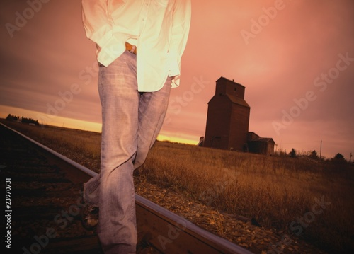 Man Walking On Train Track