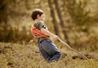 Young Boy Walking Through Woodland