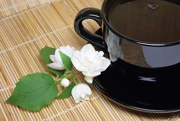 Black tea cup with jasmine