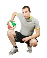 sporty man posing with ball