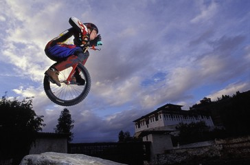 Unicyclist Taking A Jump