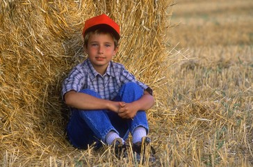 Young Boy Relaxing In Hayfield