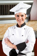 beautiful female chef portrait in kitchen