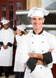 young european chef with colleagues