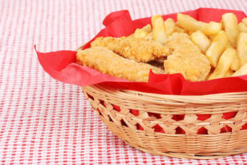 chicken fingers and french fries in a basket