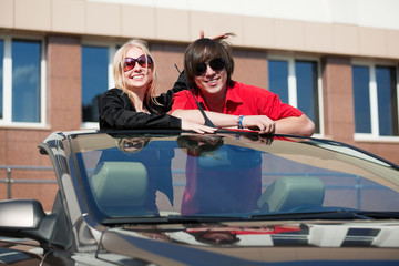 Young couple in a car.