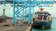 Loading of cargoes on the cargo ship. Time lapse