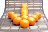 Small orange on bamboo table cloth
