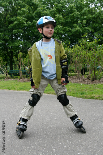 Preschooler learning to ride on rollerblades