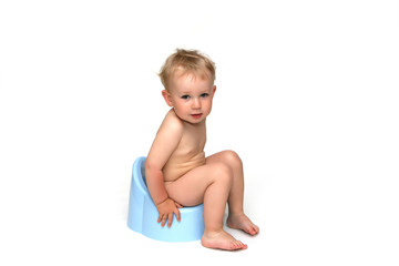baby boy sitting on his blue potty