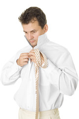The businessman puts on a shirt and a tie