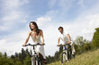Beautiful couple riding bikes