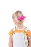 girl sniffs a flower. poster