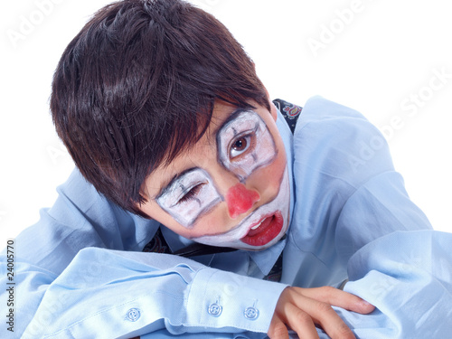 child clown persistent to stay awake with one eye open