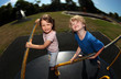 Young girl and boy playing on roundabout