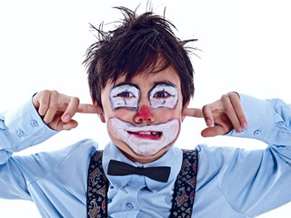child clown covering both ears with pointer fingers