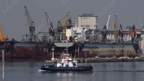 Tug-boat at the sea trading port (HD)