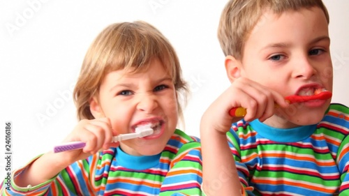 boy and girl brush teeth