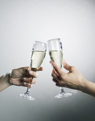 Hands holding and toasting champagne flutes