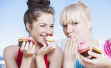 Women eating cupcakes