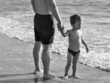 father at the beach with his son