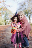 Grandmother hugging granddaughter in Halloween costume