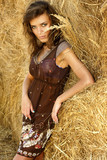 Young attractive woman in a haystack