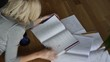 MS, PAN, Female studying on floor, London, UK