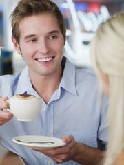 Man drinking latte in cafe