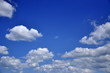 white clouds on the blue sky background