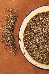 Zaatar-  a blend of herbs, sesame seeds and salt in an old ename