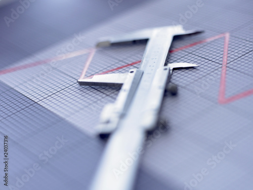Close up of vernier caliper on graph