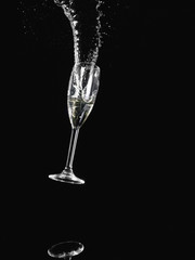 Champagne glass falling and spilling