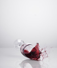 Red wine spilling from glass