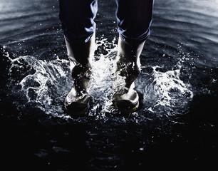 Wellingtons splashing in water