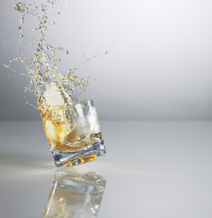 Alcohol spilling from highball glass