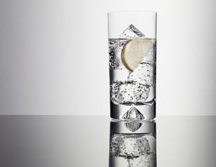 Lemon slice in glass of water