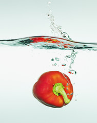 Red bell pepper splashing in water