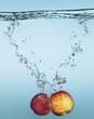 Peaches splashing in water