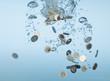 Euro coins splashing in water
