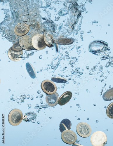 Close up of Euro coins splashing in water