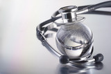 stethoscope and glass sphere