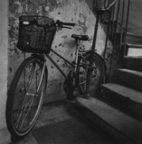 Old-fashioned bicycle in stairwell
