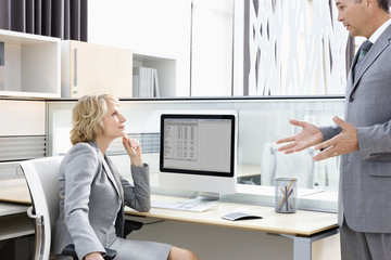 Businessman explaining to manager in office