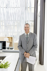 Businessman smiling in modern office