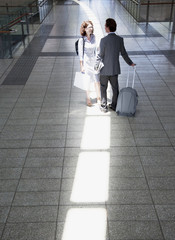 Business people talking in train station