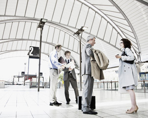 Business people waiting in train station