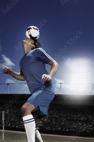 Soccer player heading soccer ball