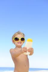 cute child  showing suncream