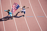Runner celebrating on track with American flag